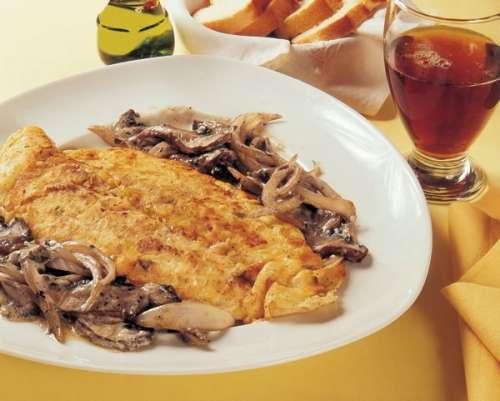 Filete de pescado con hongos y parmesano